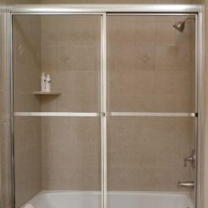 framed shower and tubs